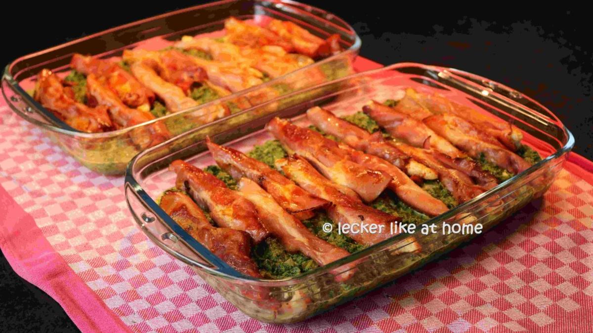 Haehnchen-Schinken-Roellchen-auf-Spinat-10-gebratene-Roellchen-auf-den-Spinat-legen